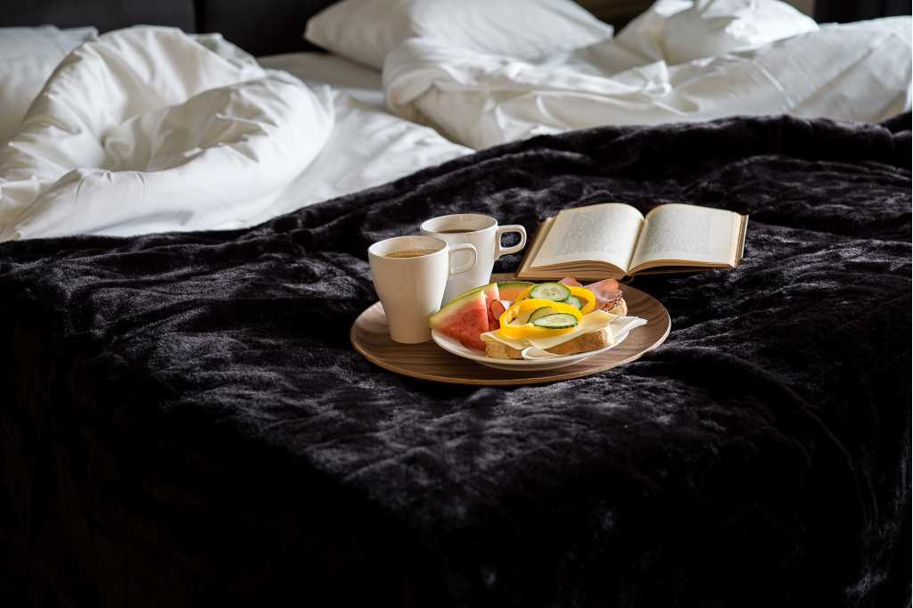 A close up on a breakfast tray on a bed