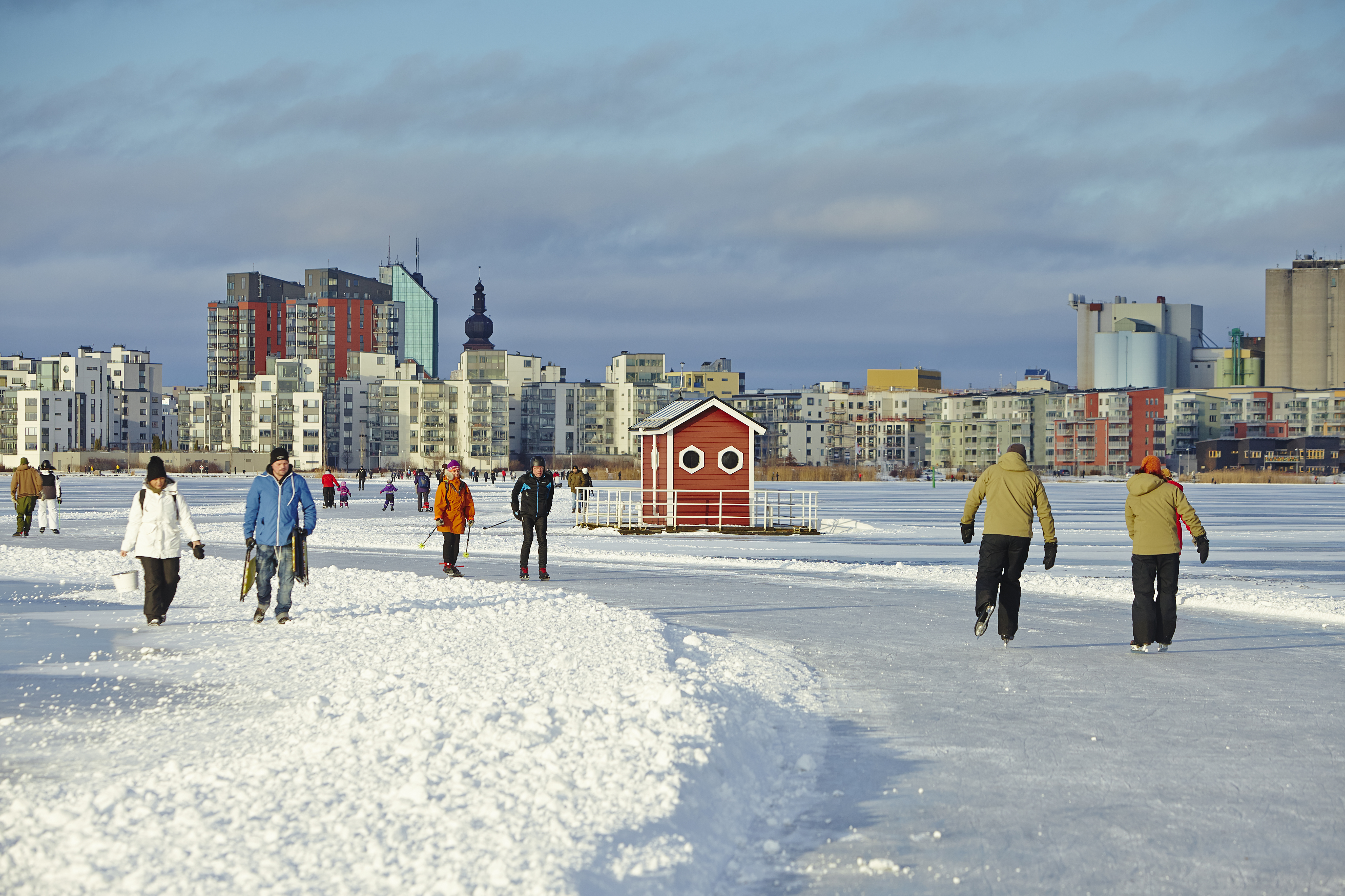 Showing Utter Inn during winter where people are skating on the frozen lake