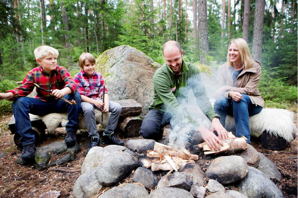 A happy family around a campfire