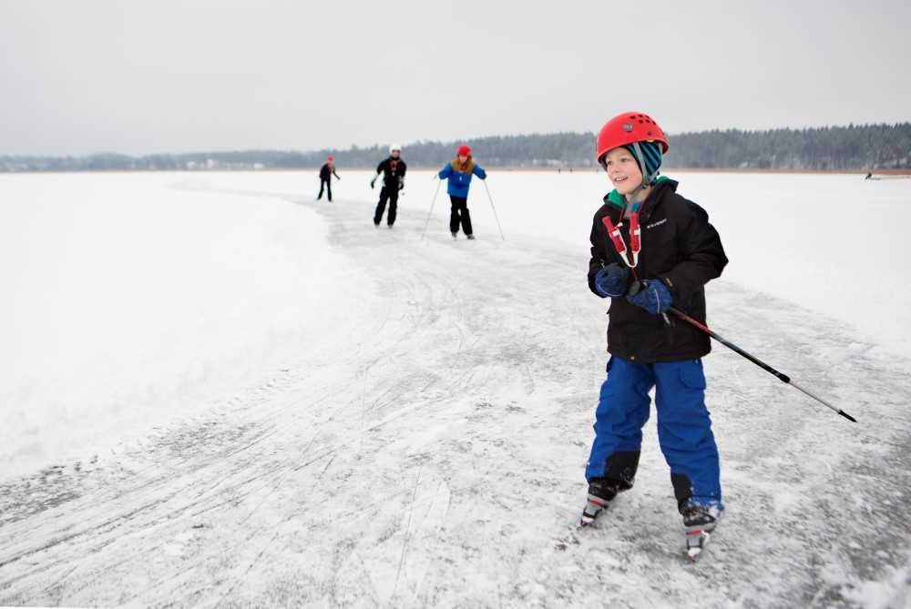 A boy ice skating on a frozen lake